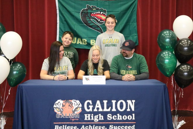 Galion's Kayla Hardy commits to play volleyball at the University of Alabama-Birmingham. Her parents Kristi and Dustin, along with brothers Mason (left) and Jimmy (right) surround her.