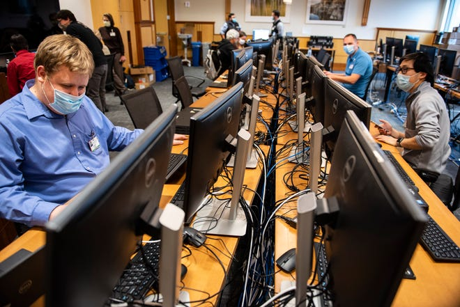 IT staff at the University of Vermont Medical Center in Burlington continue work to scan thousands of the hospital's computer systems for malware on Friday, Nov. 20, 2020, after a cyberattack forced a shutdown of the hospital's electronic medical records system and other key systems.