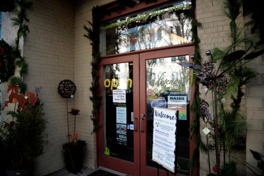 The storefront of Indigenous Craft Gallery on Madison Road in the East Walnut Hills neighborhood of Cincinnati on Monday, Nov. 23, 2020.