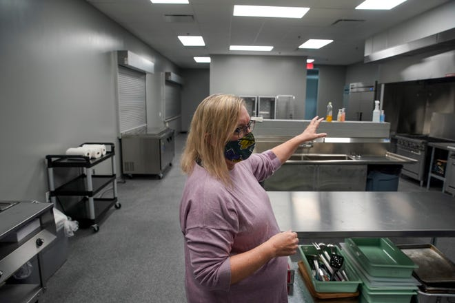 Tamara Long, the board chair, walks through a tour of the facilities and amenities at the new location for Loaves and Fishes Soup Kitchen in Clarksville, Tenn., on Wednesday, Nov. 18, 2020.