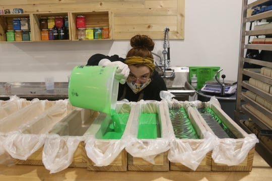 An employee at the Clarksville's Buff City Soaps makes some of their homemade soaps on Nov. 19, 2020.