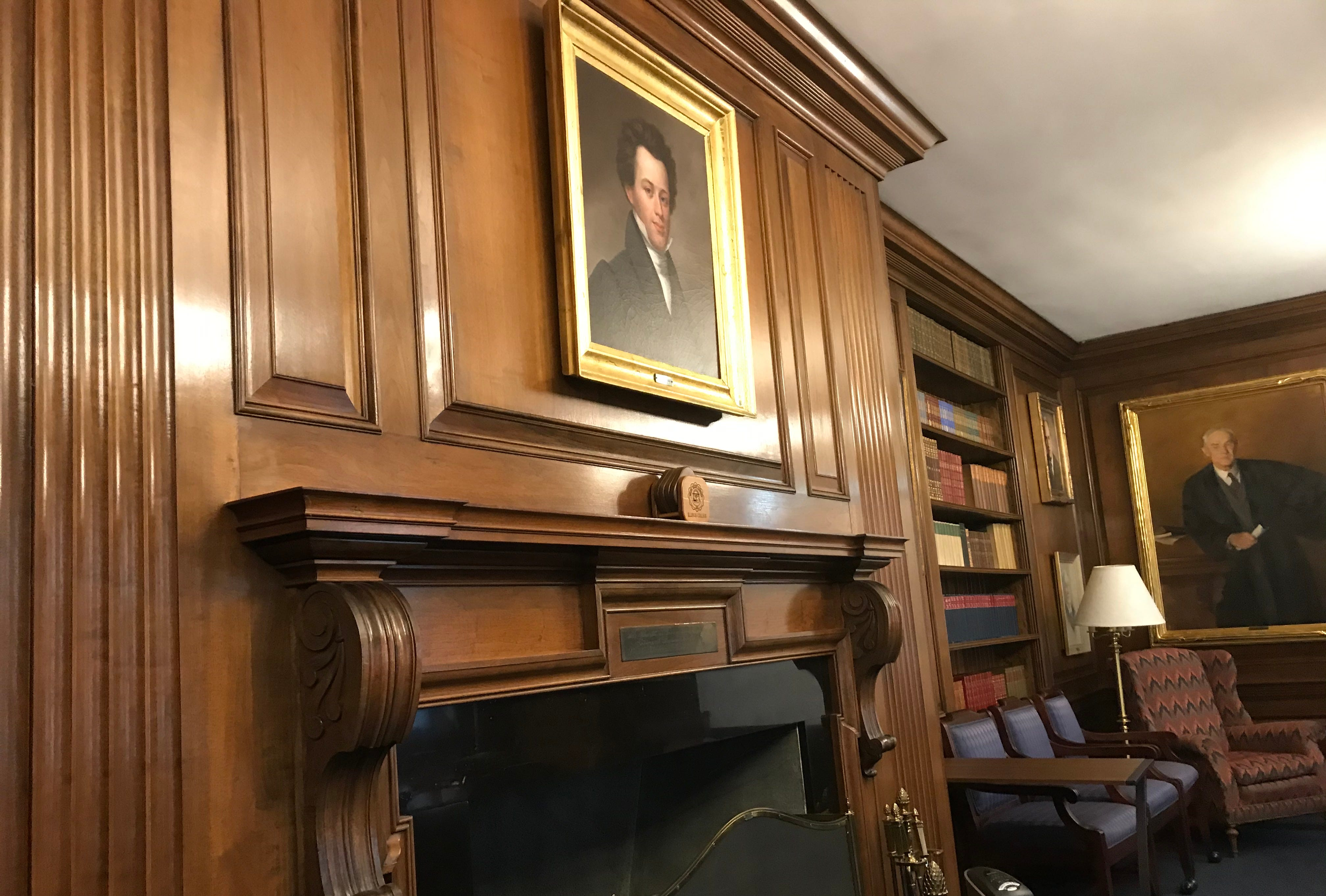 A painting of Edward Beecher, the first president of Illinois College, hangs above a fireplace in a conference room at the school.