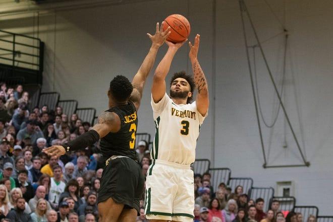 Vermont's Anthony Lamb shoots a 3-pointer over UMBC's K.J. Jackson, Feb. 22, 2020 in Burlington, Vermont.