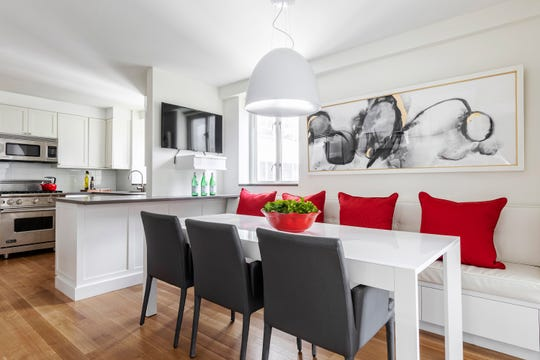 Ruby red helps add an instant burst of color to this kitchen space.