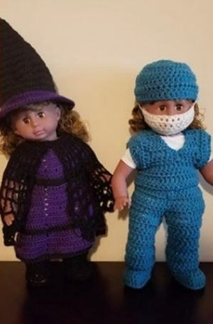 A couple of Goodfellows dolls, one of which is wearing a mask.