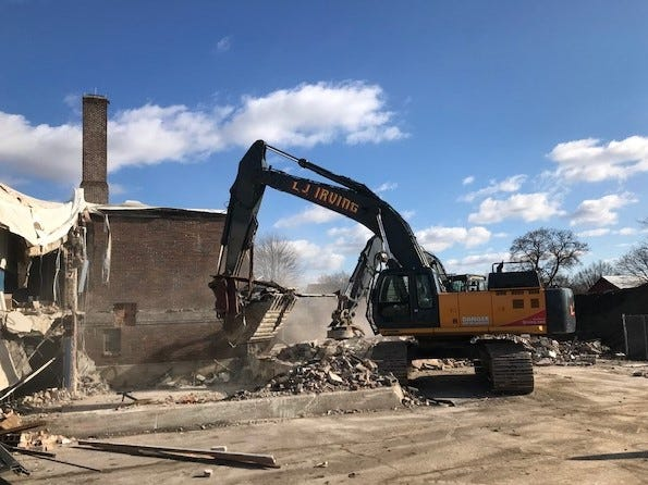 Workers from L.J. Irving Inc. began tearing down Washington Elementary School Friday. The Lindsey school was built in 1929.