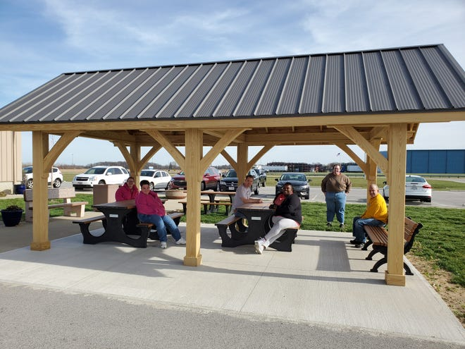 Sandco Industries workers make use of a new pavilion at its Clyde facility.