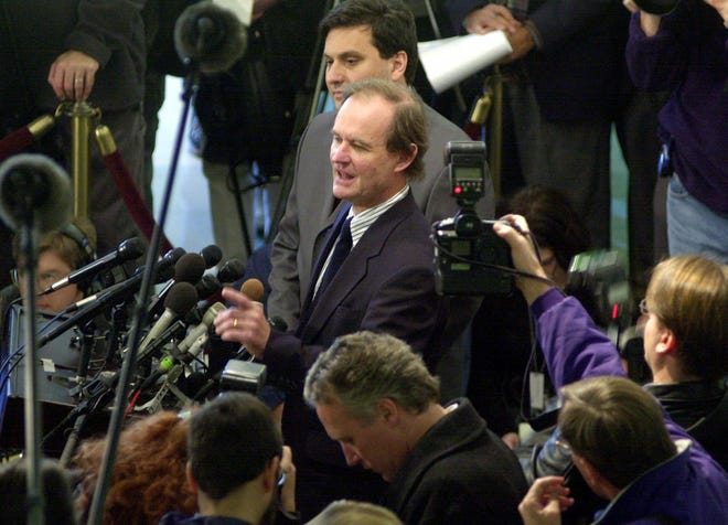 David Boies and Ron Klain are surrounded by reporters as they discuss the Supreme Court ruling that set aside the judgement of the Florida Supreme Court regarding the 2000 Florida recount.