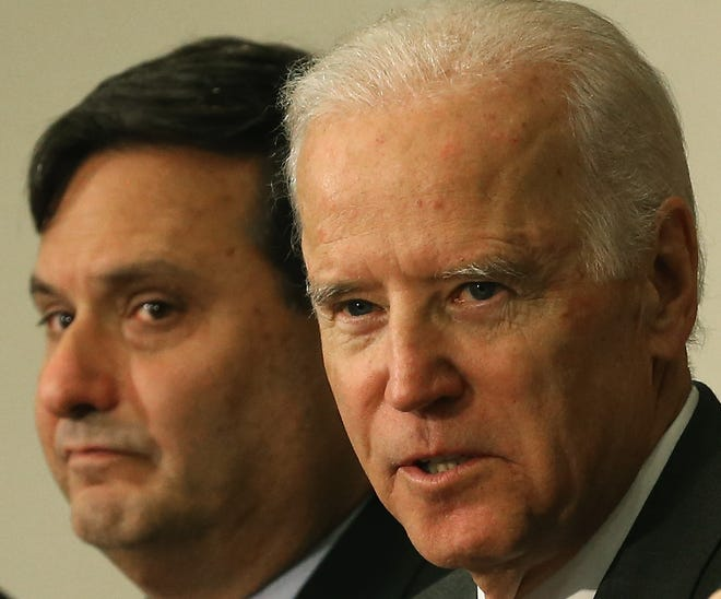 Vice President Joseph Biden (R), joined by Ebola Response Coordinator Ron Klain (L), speaks during a meeting regarding Ebola at the Eisenhower Executive office building November 13, 2014 in Washington,  D.C.