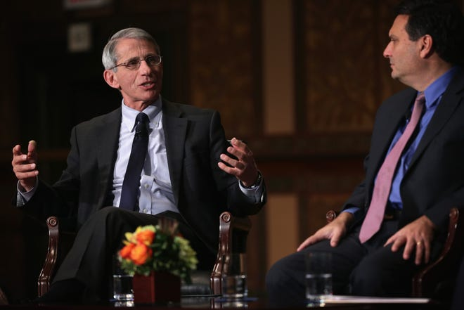 National Institute of Allergy and Infectious Diseases Director Anthony Fauci and White House Ebola Response Coordinator Ron Klain (R) participate in discussion December 5, 2014 at Georgetown University in Washington, DC.
