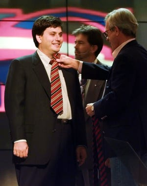 Ron Klain, Vice President Al Gore's chief of staff, stands in for his boss Wednesday afternoon, Aug. 28, 1996, as unidentified aides work out which tie the vice president should wear during his address to the Democratic National Convention in Chicago later Wednesday night.