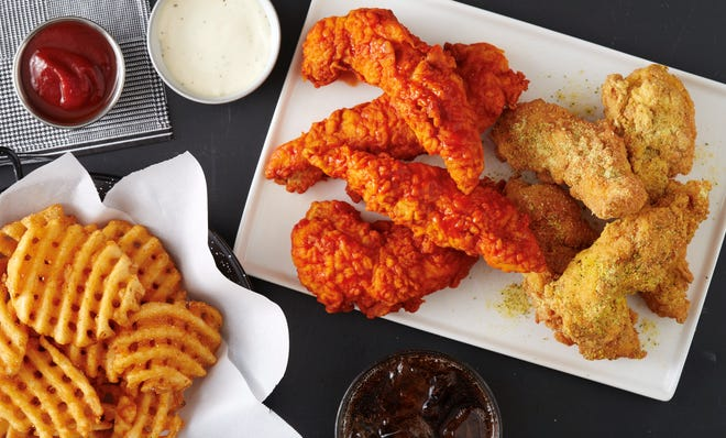 Chicken wings and chicken tenders dominate the Wings Over Knoxville menu, which also includes waffle fries, tater tots, sandwiches and wraps.