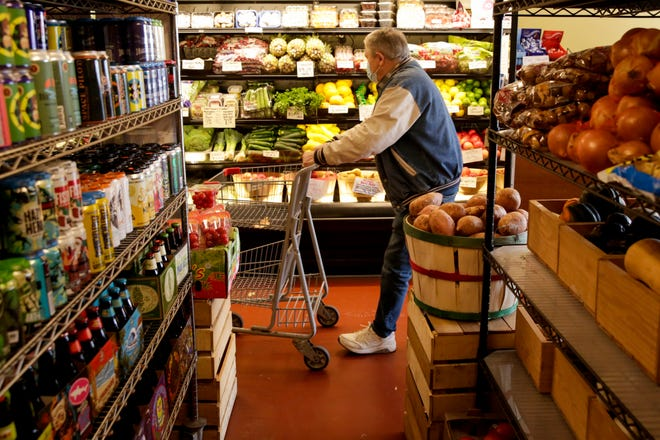 A customer shops at D&R Market, 105 N. Creasy Lane, Monday, Nov. 23, 2020 in Lafayette.