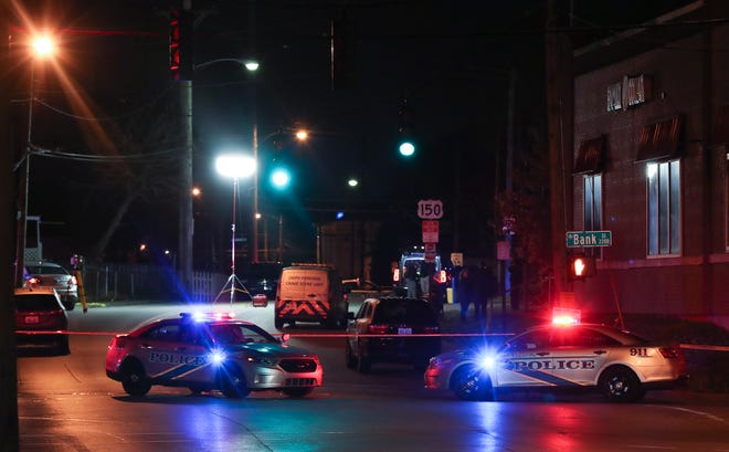 Investigators work the scene where an LMPD officer fatality shot a person near the intersection of 22nd and Gilligan streets in Louisville, Ky. on Nov. 23, 2020.