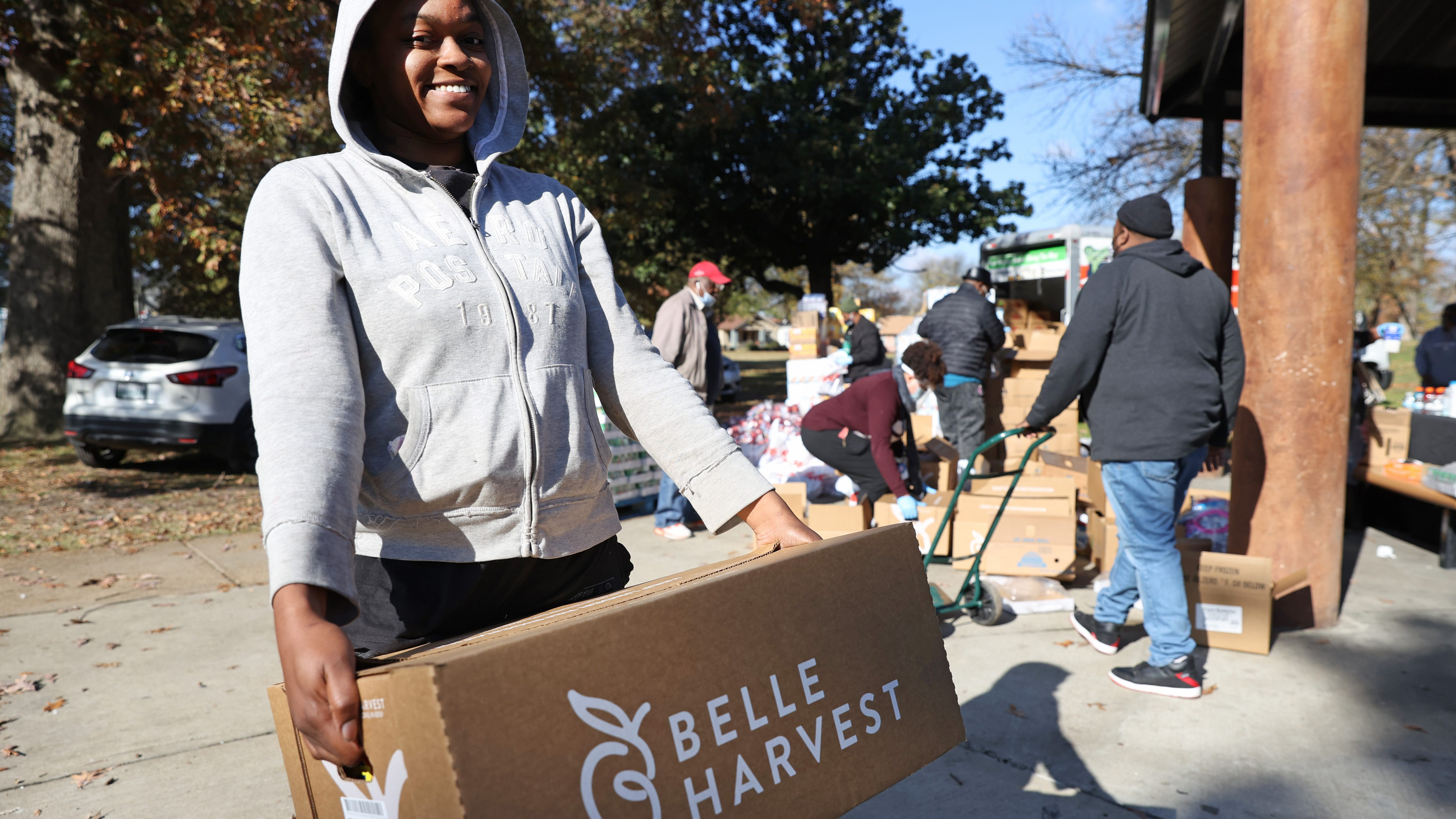 """""""My family is going to need this. I have three kids and my husband has been laid off too, so we've really had it rough all the way around,"""" said Crystal Coble as she was thanking volunteers for her free food supply at Southside Park on Monday, Nov. 23, 2020. Tracy and Keith Millbrook started their own nonprofit, We Are Family. This year, in spite of obstacles posed by COVID-19, the couple is giving away food for the 10th straight year in front of the duplex where they once raised their seven children."""