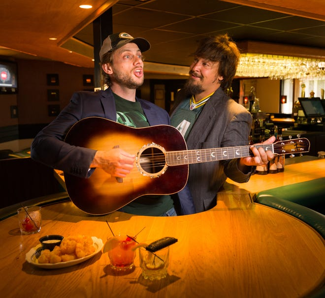 "Charlie Berens (left), the comedian behind the viral ""Manitowoc Minute"" videos, has a new album out Monday, ""Unthawed,"" he made with Adam Greuel of Wisconsin bluegrass band Horseshoes & Hand Grenades."