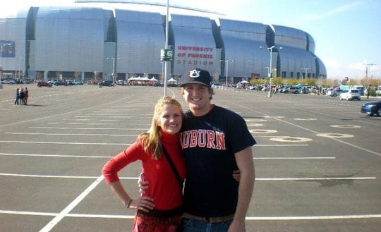 Madison and Andrew Brooks outside University of Phoenix Stadium in Glendale, Arizona – the site of the BCS National Championship game that Auburn won over Oregon.