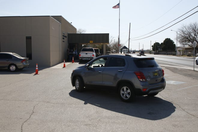 Cars gather at the San Jose Senior Center on Nov. 20, 2020 for drive-thru lunches.