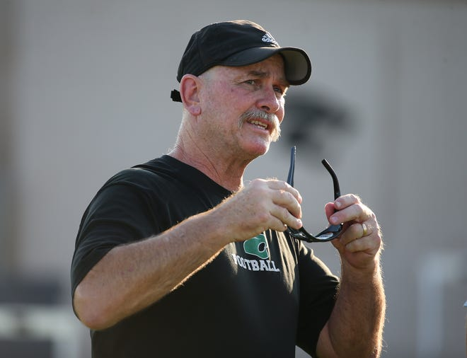 Phoenix Christian High School football head coach Brian Cole watches his team during practice in Phoenix Sept. 1 2020.