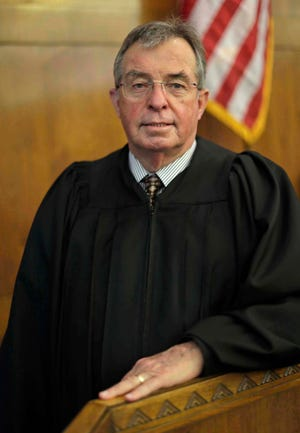 Judge L. Edward Stengel poses in Sheboygan County Circuit Court Branch 1, Monday, November 23, 2020, in Sheboygan, Wis. Stengel announced his retirement from the bench.