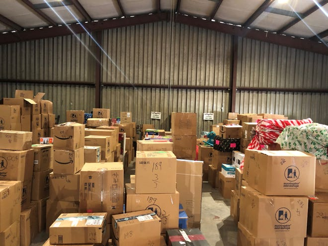 A warehouse full of boxes are packed, numbered and ready to be delivered to Christmas Connection families In 2019.