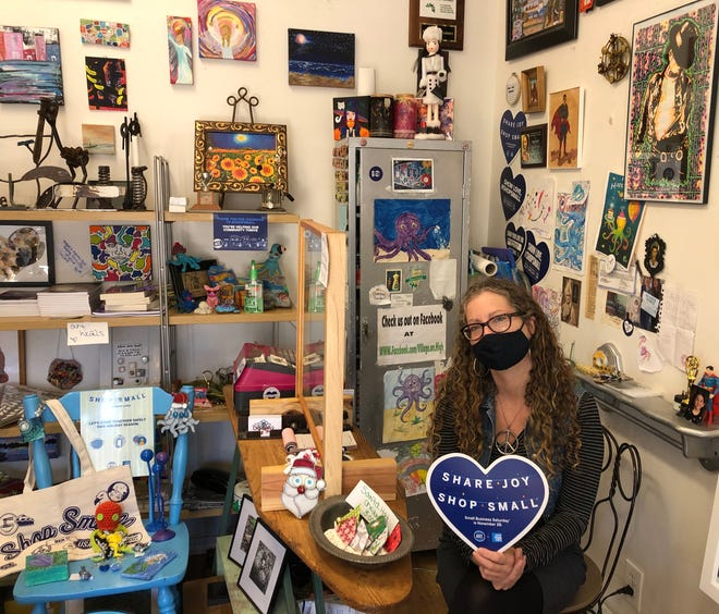 """Maryann Kuntz, owner of An Octopus's Garden in Millville, said she traditionally takes commemorative photos of customers who come in to support her shop on Small Business Saturday. This year, customers will also be able to """"visit"""" the business through a new website Kuntz launched to showcase the work of the shop's more than 95 artists."""