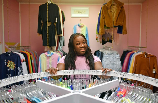 Soroya Crawford, co-owner of Pretty on Purpose, celebrated the grand opening of her Vineland, N.J., clothing and beauty shop this year. Nov. 20, 2020.