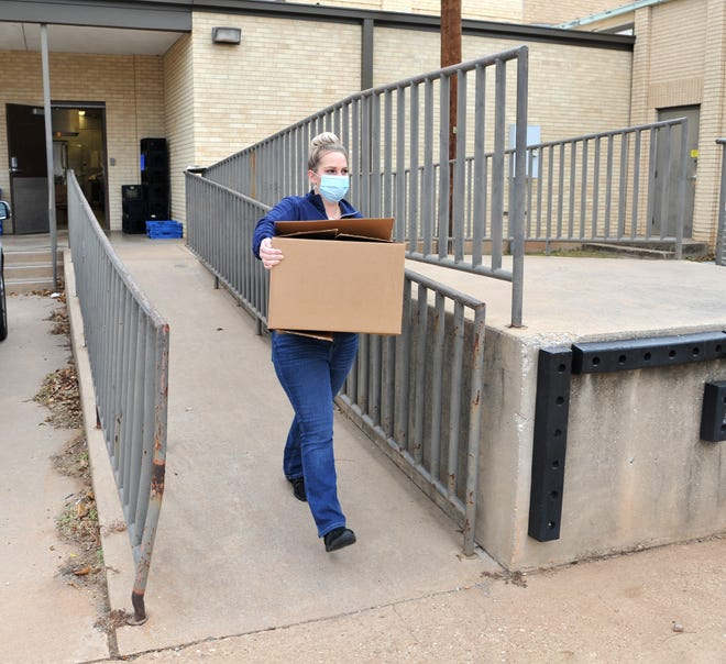 Wichita Falls Independent School District Chart Well child nutrition area supervisor, Danika Wood help deliver Thanksgiving meals at the Zundy Elementary School cafeteria as shown in this Nov. 23, 2020, file photo.
