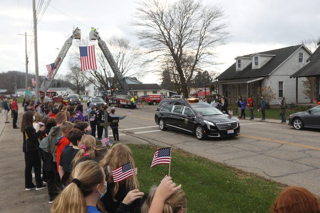 Students from Tri-Valley Middle School line Main Street in Dresden in honor of S. Sgt. Arthur E. Myers of the U.S. Air Force, who was killed when his plane crashed in the Pacific during World War II. Myers remains were repatriated and he was laid to rest in Dresden on Monday.