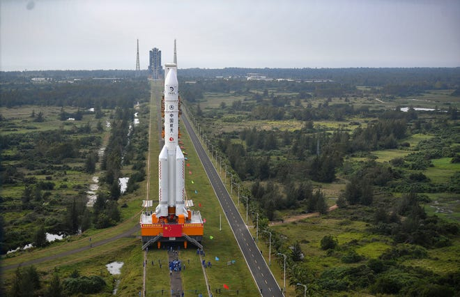 In this Nov. 17, 2020, photo released by China's Xinhua News Agency, a Long March-5 rocket is moved at the Wenchang Space Launch Site in Wenchang in southern China's Hainan Province.
