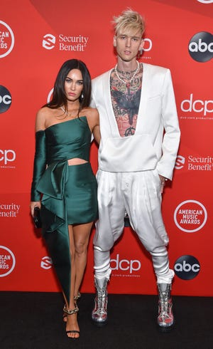Megan Fox and Machine Gun Kelly debuted their red carpet at the American Music Awards.