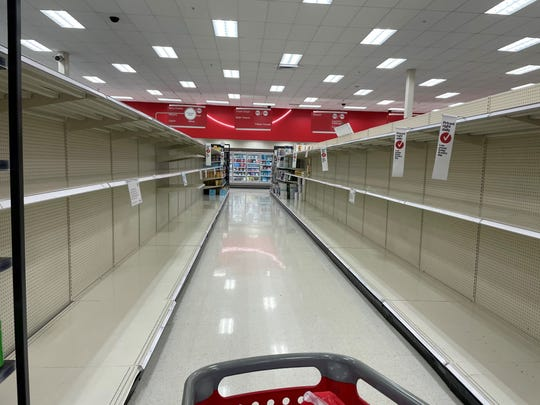 Shoppers have been stocking up on toilet paper and paper towels. At a Florida Target Sunday, only a few rolls of paper towels were available.