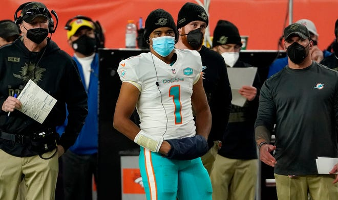 Dolphins QB Tua Tagovailoa displays the proper protection under the NFL's stronger COVID protocol.