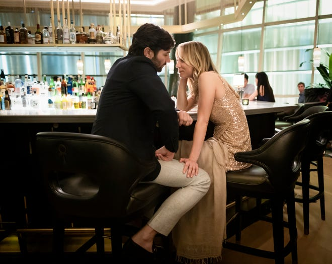 "Cassie Bowden (Kaley Cuoco) shares an intimate moment with Alex (Michiel Huisman), a passenger she met on a flight, in HBO Max's' ""The Flight Attendant."""