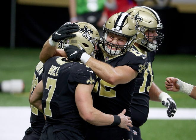 Taysom Hill of the New Orleans Saints celebrate his touchdown with teammate Adam Trautman in the third quarter against the Atlanta Falcons at Mercedes-Benz Superdome on November 22, 2020 in New Orleans, Louisiana.