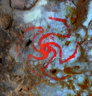A digitally enhanced image of a pinwheel painting in Pinwheel Cave, California. For the first time, a study finds evidence suggesting that a hallucinogenic plant was consumed at a rock art site and that the art is likely a representation of the plant.