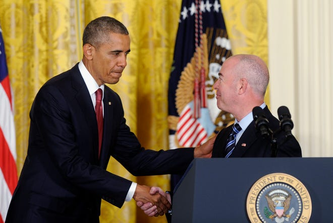 President Barack Obama shakes hands with Deputy Homeland Security Secretary Alejandro Mayorkas after a naturalization ceremony for active-duty service members and civilians on  July 4, 2014, in the East Room of the White House in Washington.