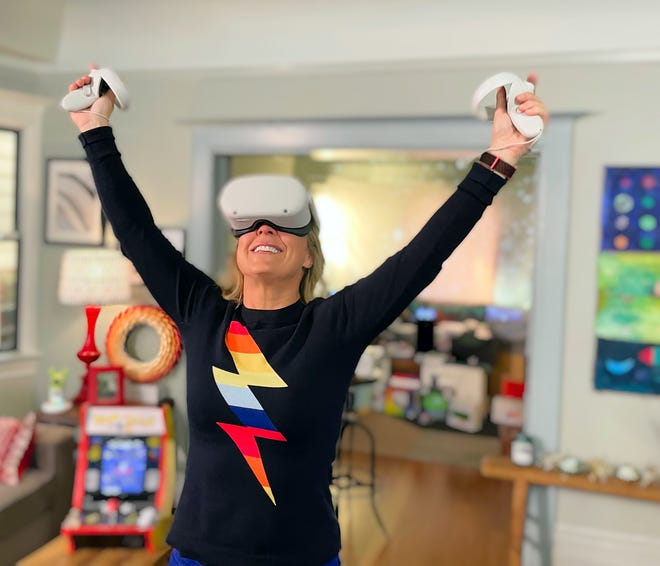 2. Jennifer Jolly plays the wireless Oculus Quest 2 at her home in Oakland, CA