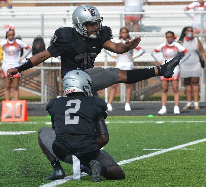 Buchtel senior Dylan West follows through on a kick during the 2020 football season.
