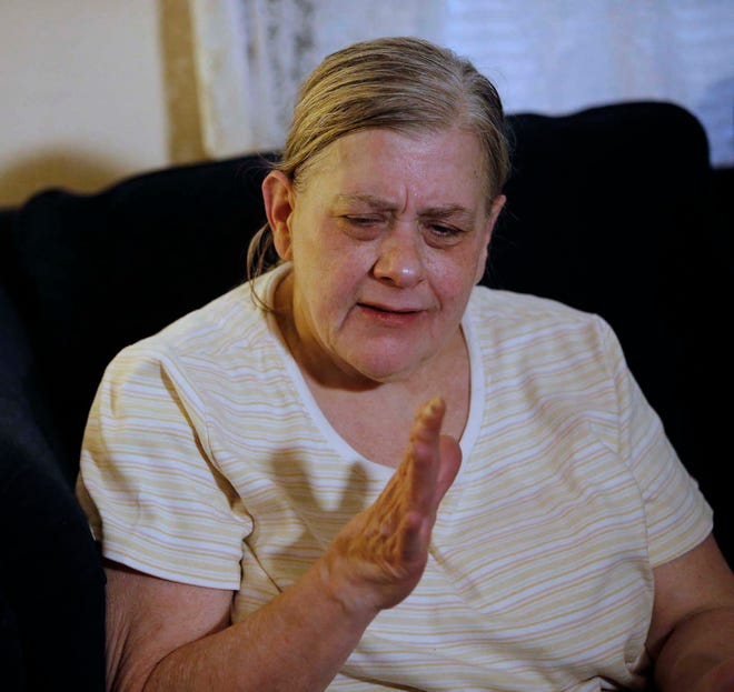 Debbie Cosgrove talks about her husband, James Cosgrove, on Tuesday in Akron. A hit-and-run driver killed him Monday evening as he walked across Manchester Road.