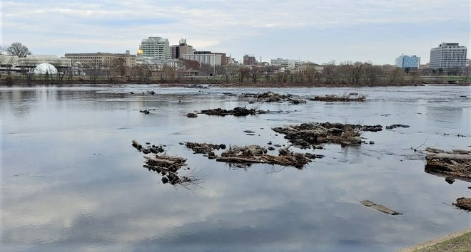 """From the top of Morrisville's levee, Trenton's golden capitol dome and its state planetarium are visible  on the far side of """"the Falls of the Delaware,"""" really no more than rapids."""