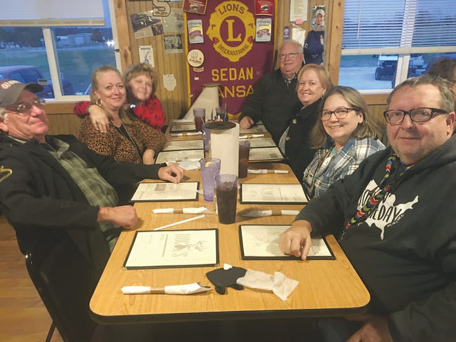 Bartlesville Wheeler Dealers Camping Club members Karla Hill, Charlotte and Gary Piersall; Ponca City members Lee and Ellen Cobb and Sand Springs members Bill and Pam Doyle visit while awaiting their steak dinners at Buck's BBQ in Sedan, Kansas.
