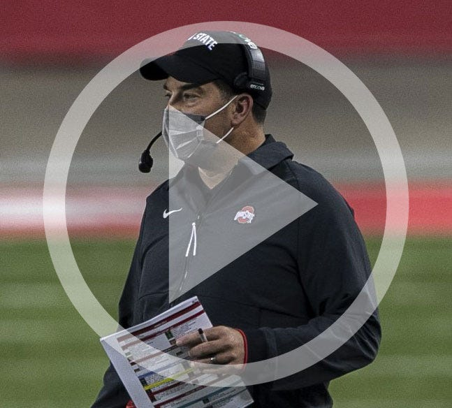 In this file photo, Ohio State Buckeyes head coach Ryan Day calls a play during the first quarter of the NCAA football game against the Rutgers Scarlet Knights at Ohio Stadium in Columbus, Ohio on Sunday, Nov. 8, 2020. Ohio State won 49-27.