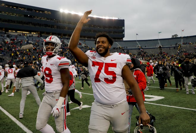 Ohio State left tackle Thayer Munford (75), here celebrating as he leaves the field after a victory at Michigan last season, has blossomed in his third year as a Buckeyes starter.