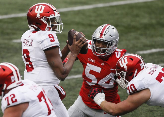 Ohio State defensive end Tyler Friday (54) applies pressure on Indiana quarterback Michael Penix Jr. in last Saturday's game against the Hoosiers. Friday did not get the sack, and the Buckeyes recorded only two sacks of Penix.