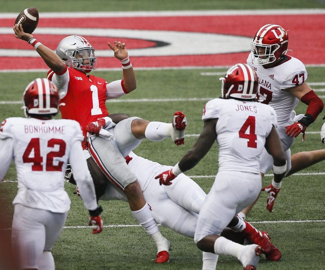 Two poor decisions against Indiana on Saturday led to interceptions by Ohio State quarterback Justin Fields, including this third-quarter heave when Fields tried to avoid a sack.