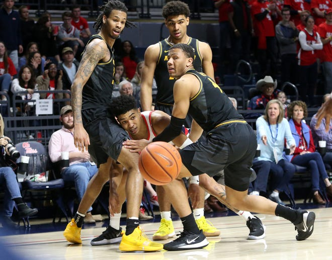 Missouri forward Mitchell Smith, left, and guards Mark Smith, back, and Javon Pickett, right, trap against Mississippi guard Breein Tyree during a game March 4 at The Pavilion at Ole Miss in Oxford, Miss.