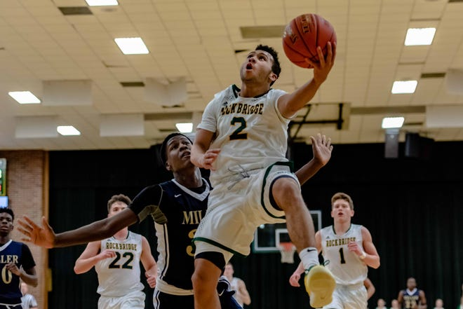 Rock Bridge's Xavier Sykes (2) elevates for a layup during a game against Miller Career Academy on Jan. 23 at Rock Bridge High School.