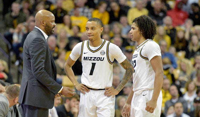Missouri head men's basketball coach Cuonzo Martin talks with guards Xavier Pinson (1) and Dru Smith (12) during a game against Auburn on Feb. 15 at Mizzou Arena.