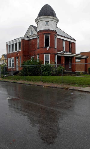 Columbus Landmarks tried to buy this Queen Anne house at 1235 W. Broad St. in Franklinton using a new fund that allows the preservation group to purchase property. The offer wasn't accepted and the house was demolished.